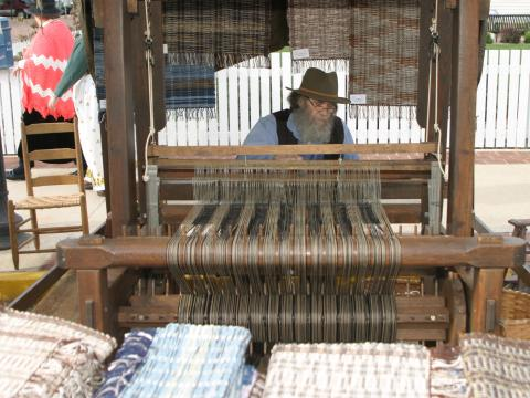 Working the loom at the Folklife Festival