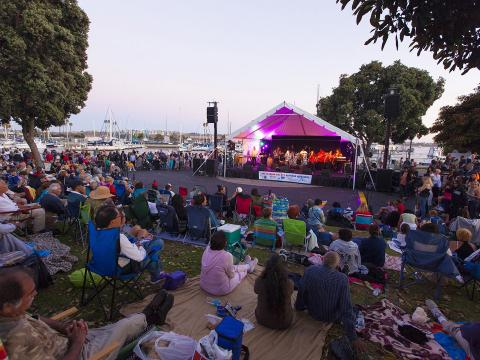 Crowds listen to the live band performing during Marina del Rey's Summer Concert Series