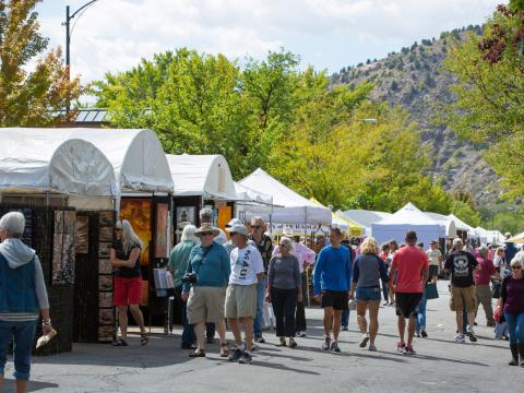Browsing vendor booths at the Autumn Arts Festival in Durango