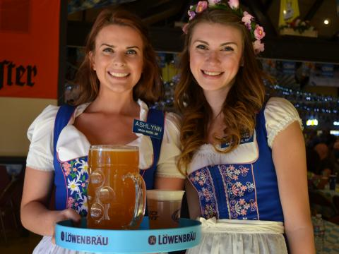 Posing with German beers in traditional costume at Big Bear Lake Oktoberfest