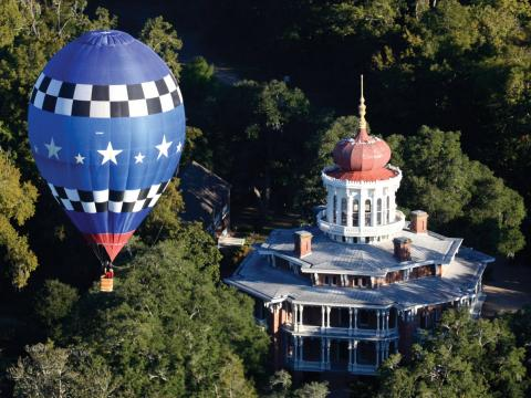 A hot air balloon floating over Longwood mansion in Natchez, Mississippi
